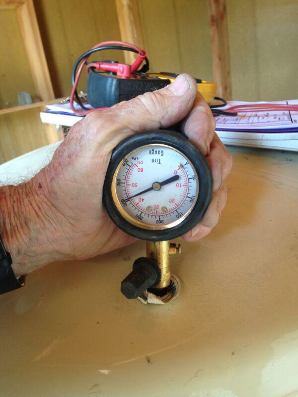 Checking bladder tank precharge