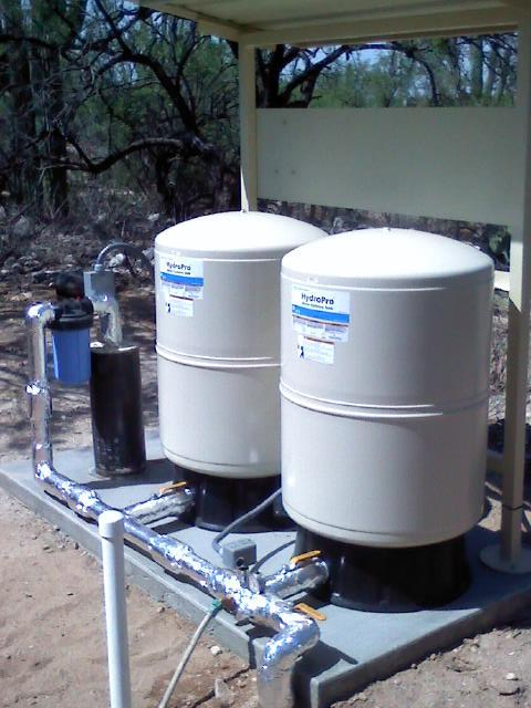 Two tanks and a well