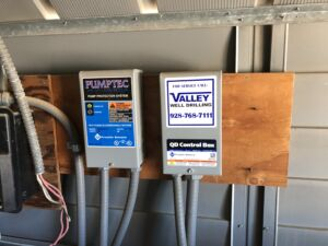 Figure 2. A fractional horsepower pump controller (left) and a run dry protection device (right) installed by a water well contractor.