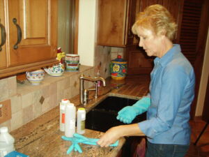 A well owner preparing to sample her well water for testing